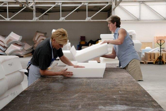 Woman bonding pieces of foam with SABA adhesive