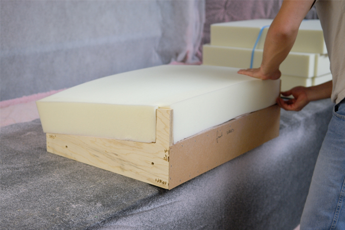 Man assembling furniture piece with water-based adhesive