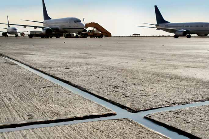 Airport runway sealed with chemical resistant SABA sealant.